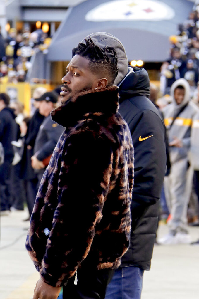 In this photo from Dec. 30, 2018, Pittsburgh Steelers wide receiver Antonio Brown stands on the sideline before an NFL football game against the Cincinnati Bengals, in Pittsburgh. Pittsburgh Steelers head coach Mike Tomlin says he's disappointed in the behavior of star wide receiver Antonio Brown but added the team has not received any formal trade request from Brown's camp. Brown did not play in Pittsburgh's victory over Cincinnati in the regular season finale due in part to a lack of communication from Brown about his health. (AP Photo/Gene J. Puskar)