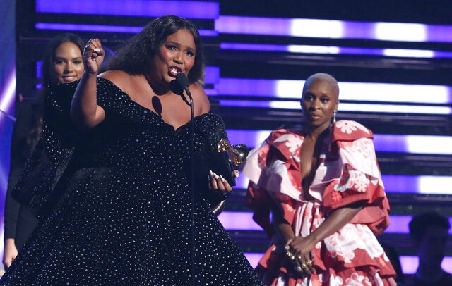 Lizzo accepts the award for best pop solo performance for