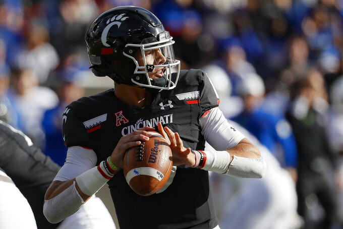 Cincinnati quarterback Desmond Ridder (9) passes during the first half of an NCAA college football game against Tulsa, Saturday, Oct. 19, 2019, in Cincinnati. (AP Photo/John Minchillo)