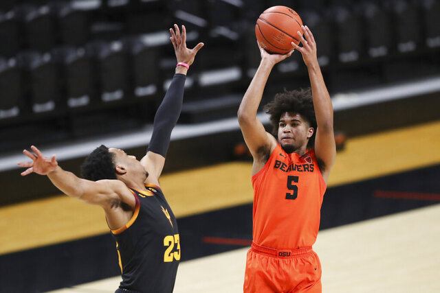 Oregon State's Ethan Thompson (5) shoots over Arizona State's Marcus Bagley (23) during the first half of an NCAA college basketball game in Corvallis, Ore., Saturday, Jan. 16, 2021. (AP Photo/Amanda Loman)