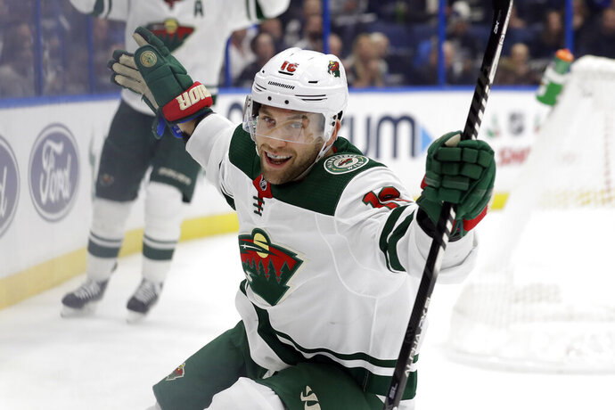 Minnesota Wild left wing Jason Zucker celebrates his goal against the Tampa Bay Lightning during the first period of an NHL hockey game Thursday, Dec. 5, 2019, in Tampa, Fla. (AP Photo/Chris O'Meara)