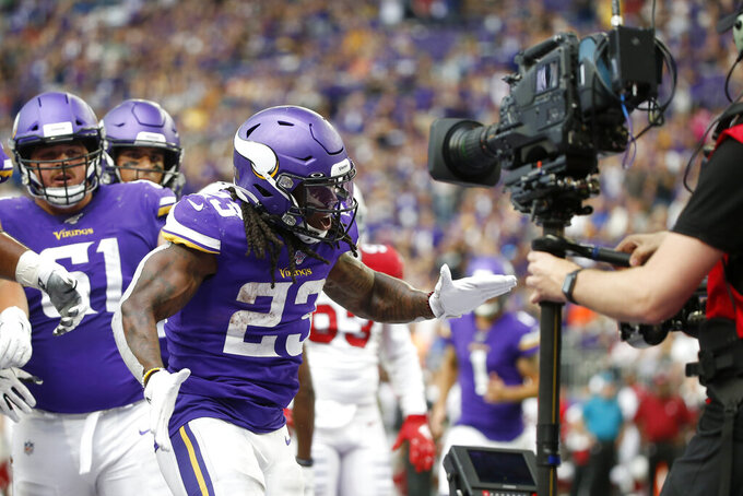 Minnesota Vikings running back Mike Boone (23) celebrates after scoring on a 7-yard touchdown run during the second half of an NFL preseason football game against the Arizona Cardinals, Saturday, Aug. 24, 2019, in Minneapolis. (AP Photo/Bruce Kluckhohn)