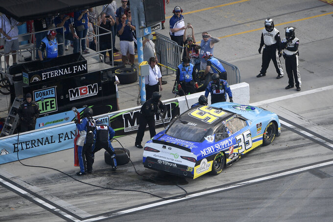 Joey Gase (35) gets work done on pit road during a NASCAR Xfinity Series auto race at Daytona International Speedway Saturday, Feb. 16, 2019, in Daytona Beach, Fla. (AP Photo/Phelan M. Ebenhack)