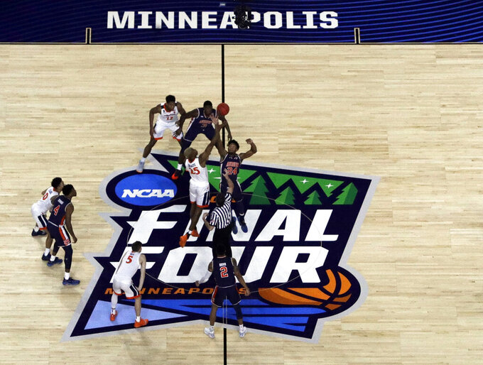 Virginia's Mamadi Diakite (25) and Auburn's Anfernee McLemore (24) reach for the tipoff at the start of the first half in the semifinals of the Final Four NCAA college basketball tournament, Saturday, April 6, 2019, in Minneapolis. (AP Photo/Morry Gash)