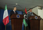 Abdul Hamid Dbeibeh, the Prime Minister of the Government of National Unity, right, and Mario Draghi, the Prime Minister of Italy, speak to media, Tuesday, April, 6 2021 in Tripoli, Libya. (AP Photo/Nada Harib)