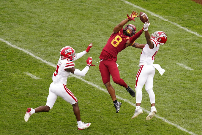 Louisiana-Lafayette safety Percy Butler, left, and cornerback Eric Garror, right, breaks up a pass intended for Iowa State wide receiver Xavier Hutchinson (8) during the first half of an NCAA college football game, Saturday, Sept. 12, 2020, in Ames, Iowa. (AP Photo/Charlie Neibergall)