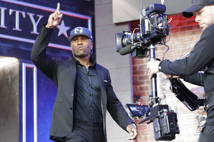 Vanderbilt cornerback Joejuan Williams enters the main stage after the New England Patriots selected Williams during the second round of the NFL football draft, Friday, April 26, 2019, in Nashville, Tenn. (AP Photo/Mark Humphrey)