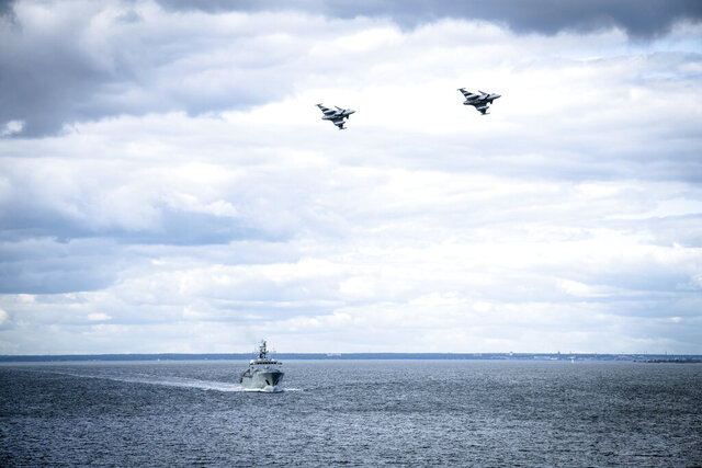 "In this photo provided by the Swedish Armed Forces on Tuesday, Aug. 25, 2020, troops patrol by both air and sea in the Baltic Sea region. Sweden is stepping up its defense activities in the Baltic Sea due to ""a deteriorating security situation"" as Russia and NATO conduct military operations in the area. The Swedish armed forces said Tuesday that it initiated a ""high-readiness action"" in the southeastern and southern Baltic Sea due to the ""current, extensive military activity"" in the region.  (Antonia Sehlstedt/Swedish Armed Forces/TT via AP)"