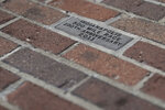 "A message honoring the 100th anniversary of the Indianapolis 500 is located in the middle of the ""Yard of Bricks"" at the Indianapolis Motor Speedway, Sunday, May 24, 2020, in Indianapolis. (AP Photo/Darron Cummings)"