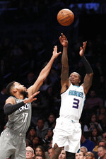 Charlotte Hornets guard Terry Rozier (3) shoots with Brooklyn Nets guard Garrett Temple (17) defending during the first half of an NBA basketball game, Wednesday, Dec. 11, 2019, in New York. (AP Photo/Kathy Willens)