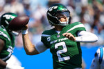New York Jets quarterback Zach Wilson passes against the Carolina Panthers during the first half of an NFL football game Sunday, Sept. 12, 2021, in Charlotte, N.C. (AP Photo/Jacob Kupferman)
