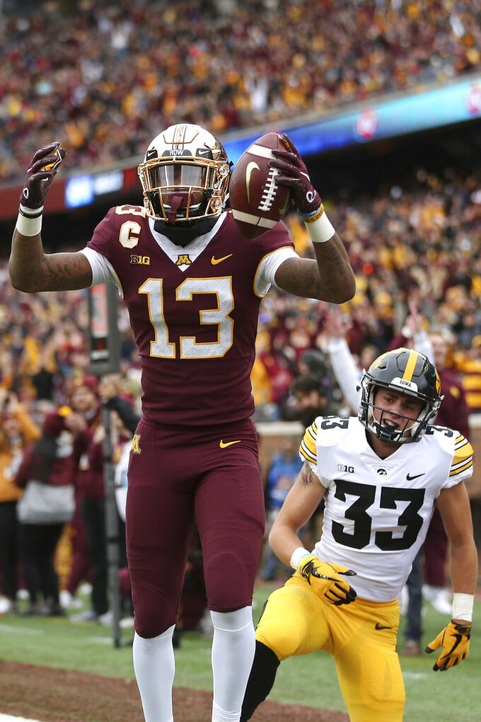 Minnesota wide receiver Rashod Bateman reacts after scoring a touchdown against Iowa during an NCAA college football game Saturday, Oct. 6, 2018, in Minneapolis. (AP Photo/Stacy Bengs)