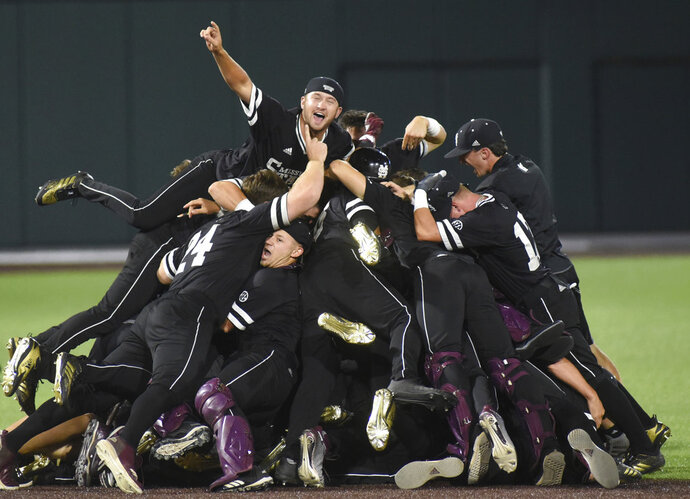 FILE - In this June 11, 2018, file photo, Mississippi State celebrates after beating Vanderbilt 10-6 in an NCAA college baseball tournament super regional game in Nashville, Tenn. The opening weekend of Mississippi State's baseball season couldn't have been much more demoralizing. The proud program lost three straight games, lost its head coach and had gained multiple excuses to totally fall apart. Instead, their season will end at the College World Series. (AP Photo/Mike Strasinger, File)