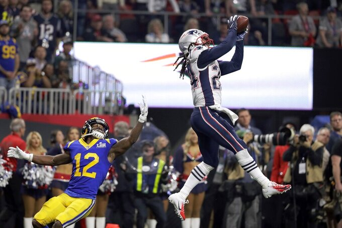 New England Patriots' Stephon Gilmore, right, intercepts a pass intended for Los Angeles Rams' Brandin Cooks (12) during the second half of the NFL Super Bowl 53 football game Sunday, Feb. 3, 2019, in Atlanta. (AP Photo/Chuck Burton)