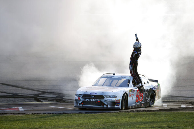 Chase Briscoe stands on his car as he celebrates after winning a NASCAR Xfinity Series auto race, Saturday, July 27, 2019, at Iowa Speedway in Newton, Iowa. (AP Photo/Matthew Putney)