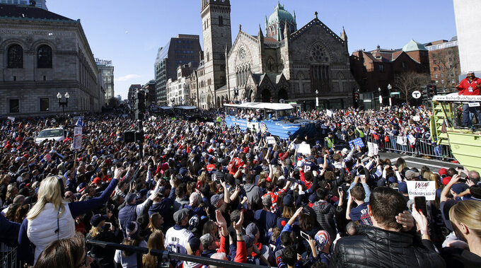 A huge crowd of fans cheer the New England Patriots as they parade through downtown Boston, Tuesday, Feb. 5, 2019, to celebrate their win over the Los Angeles Rams in Sunday's NFL Super Bowl 53 football game in Atlanta. (AP Photo/Steven Senne)