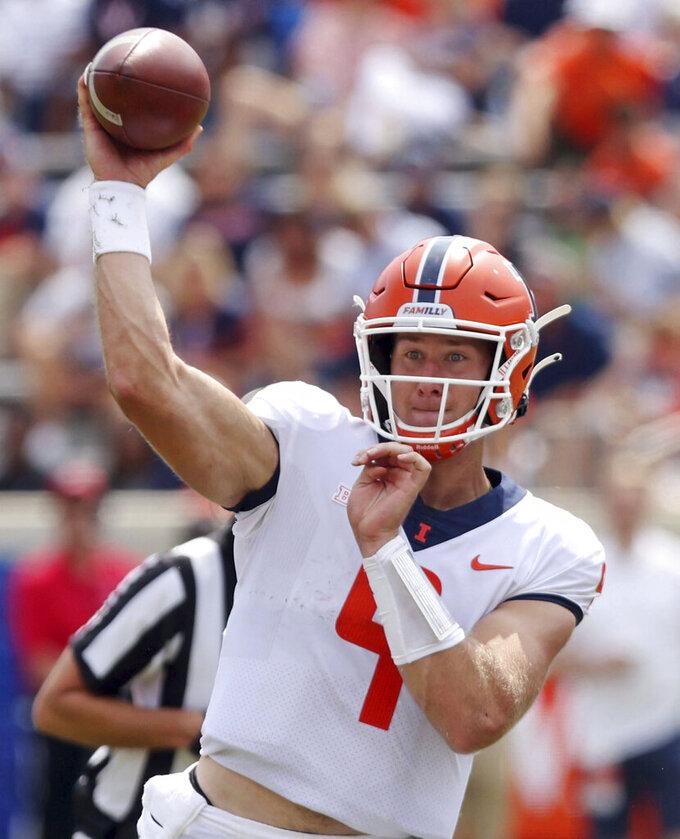 Illinois quarterback Artur Sitkowski (9) throws a pass against Illinoisduring an NCAA college football game, Saturday, Sept. 11, 2021, at Scott Stadium in Charlottesville, Va. (Andrew Shurtleff/The Daily Progress via AP)