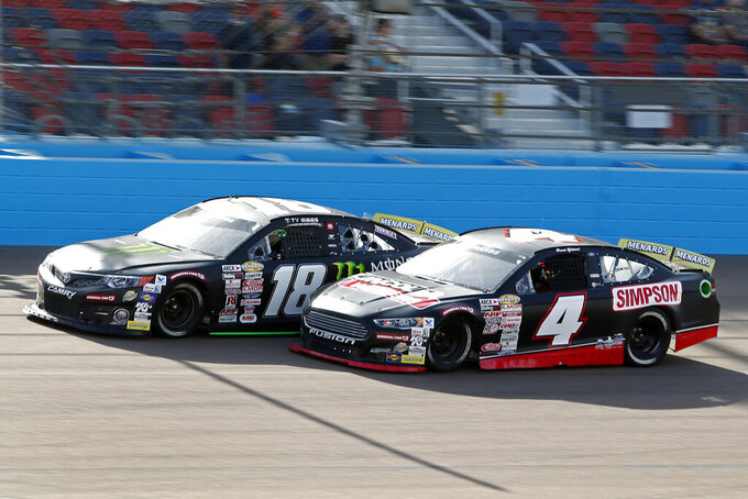 Ty Gibbs (18) and David Gilliland (4) race for the lead through Turn 4 during the ARCA Series auto race at Phoenix Raceway, Saturday, Nov. 7, 2020, in Avondale, Ariz. (AP Photo/Ralph Freso)