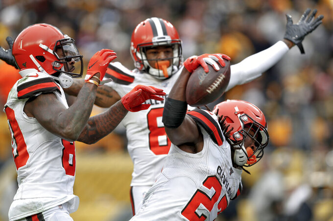 Cleveland Browns running back Kareem Hunt (27) celebrates after scoring a touchdown against the Pittsburgh Steelers in the first half of an NFL football, Sunday, Dec. 1, 2019, in Pittsburgh. (AP Photo/Don Wright)