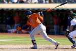 Houston Astros' Yuli Gurriel hits an RBI-double against the Oakland Athletics in the sixth inning of a baseball game in Oakland, Calif., Sunday, Sept. 26, 2021. (AP Photo/John Hefti)