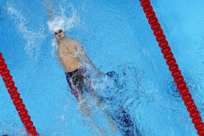 Evgeny Rylov, of the Russian Olympic Committee, swims to victory in the men's 200m backstroke final at the 2020 Summer Olympics, Friday, July 30, 2021, in Tokyo, Japan. (AP Photo/Jeff Roberson)
