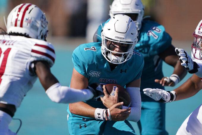 Coastal Carolina quarterback Jarrett Guest runs against Massachusetts during the second half of an NCAA college football game on Saturday, Sept. 25, 2021, in Conway, S.C. (AP Photo/Chris Carlson)