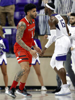 Texas Tech guard Brandone Francis (1) celebrates sinking a 3-point basket in front of TCU forward JD Miller (15) in the second half of an NCAA college basketball game in Fort Worth, Texas, Saturday, March 2, 2019. (AP Photo/Tony Gutierrez)