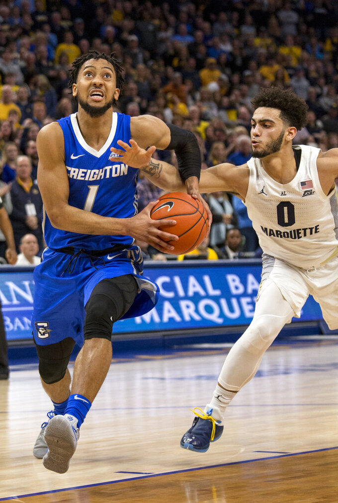 Creighton guard Davion Mintz, left, drives to the basket against Marquette guard Markus Howard, right, during the second half of an NCAA college basketball game Sunday, March 3, 2019, in Milwaukee. (AP Photo/Darren Hauck)