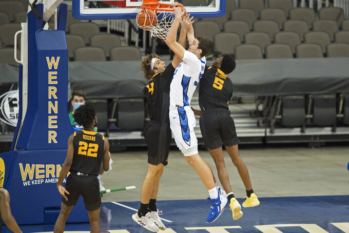 Creighton's Ryan Kalkbrenner scores against Kennesaw State's Cole LaRue, left, and Brandon Stroud during the first half of an NCAA college basketball game in Omaha, Neb., Friday, Dec. 4, 2020. (AP Photo/Kayla Wolf)