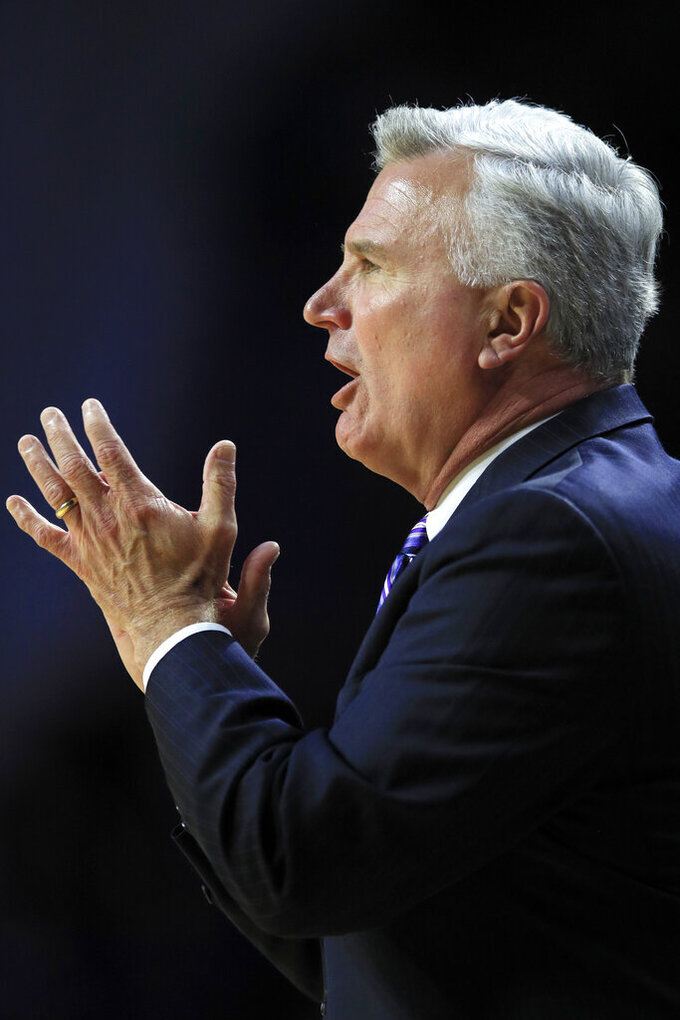 Kansas State coach Bruce Weber applauds his team during the first half of an NCAA college basketball game against Oklahoma in Manhattan, Kan., Wednesday, Jan. 29, 2020. (AP Photo/Orlin Wagner)