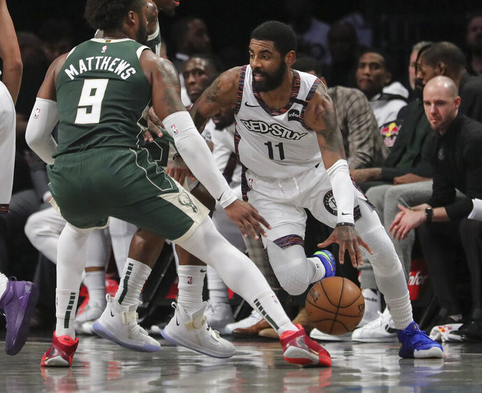 Brooklyn Nets Brooklyn Nets guard Kyrie Irving, right, drives on Milwaukee Bucks guard Wesley Matthews, left, during a NBA basketball game, Saturday, Jan. 18, 2020, in New York. (AP Photo/Bebeto Matthews)
