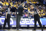 West Virginia coach Bob Huggins speaks with an official during the first half of an NCAA college basketball game against Missouri Saturday, Jan. 25, 2020, in Morgantown, W.Va. (AP Photo/Kathleen Batten)