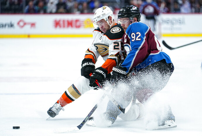 Colorado Avalanche left wing Gabriel Landeskog (92) and Anaheim Ducks center Devin Shore (29) go after the puck during the first period of an NHL hockey game Saturday, Oct. 26, 2019, in Denver. (AP Photo/Jack Dempsey)