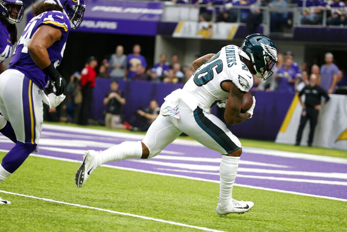 Philadelphia Eagles running back Miles Sanders, right, catches a 32-yard touchdown pass ahead of Minnesota Vikings middle linebacker Eric Kendricks, left, during the first half of an NFL football game, Sunday, Oct. 13, 2019, in Minneapolis. (AP Photo/Bruce Kluckhohn)