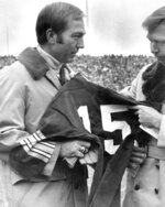 FILE - In this Nov. 12, 1973, file photo, former Green Bay Packers quarterback Bart Starr accepts jersey No. 15 as the number was retired during halftime ceremonies of the Green Bay vs St. Louis Cardinals football game in Green Bay, Wisc. Starr, the Green Bay Packers quarterback and catalyst of Vince Lombardi's powerhouse teams of the 1960s, has died. He was 85. The Packers announced Sunday, May 26, 2019, that Starr had died, citing his family. He had been in failing health since suffering a serious stroke in 2014. (AP Photo/File)