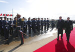 Algeria's President Abdelmadjid Tebboune, right, and Turkey's President Recep Tayyip Erdogan review a military honour guard during a welcoming ceremony at the airport, in Algiers, Algeria, Sunday, Jan. 26, 2020. Erdogan is in Algeria as first step of his three-nation Africa tour. (Turkish Presidency via AP, Pool)