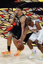 Phoenix Suns guard Chris Paul (3) knocks the ball away from Atlanta Hawks guard Bogdan Bogdanovic (13) in the second half of an NBA basketball game Wednesday, May 5, 2021, in Atlanta. (AP Photo/John Bazemore)