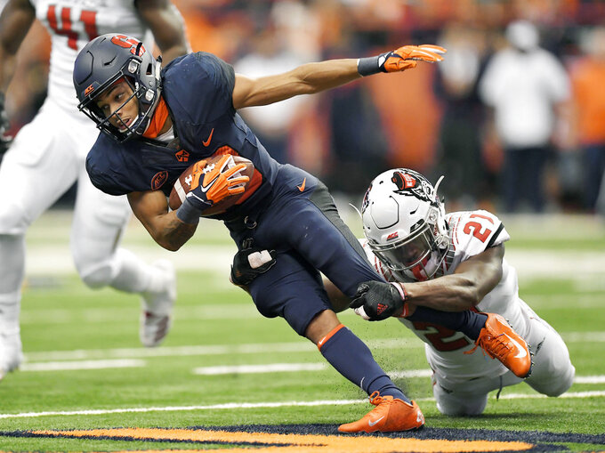 Syracuse wide receiver Sean Riley, left, is tackled by NC State defensive back Stephen Griffin during the first half of an NCAA college football game in Syracuse, N.Y., Saturday, Oct. 27, 2018. (AP Photo/Adrian Kraus)