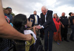 Democratic presidential candidate U.S. Sen. Bernie Sanders shakes the hand of Alyce Martinez outside Comanche Nation Arena prior to the beginning of the annual Comanche Nation Fair Powwow, Sunday, Sept. 22, 2019, in Lawton, Okla. (AP Photo/Gerardo Bello)