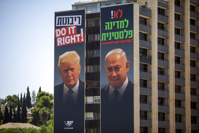 Billboards shows Israeli Prime Minister Benjamin Netanyahu, right, and U.S President Donald Trump in Jerusalem, placed by Yesha Council, an organization of municipal councils of Jewish settlements in the West Bank, Wednesday, June 10, 2020. Hebrew on billboard reads