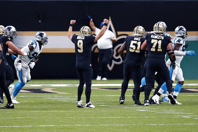 New Orleans Saints quarterback Drew Brees (9) celebrates his touchdown pass to end the first half of an NFL football game against the Carolina Panthers in New Orleans, Sunday, Oct. 25, 2020. (AP Photo/Butch Dill)