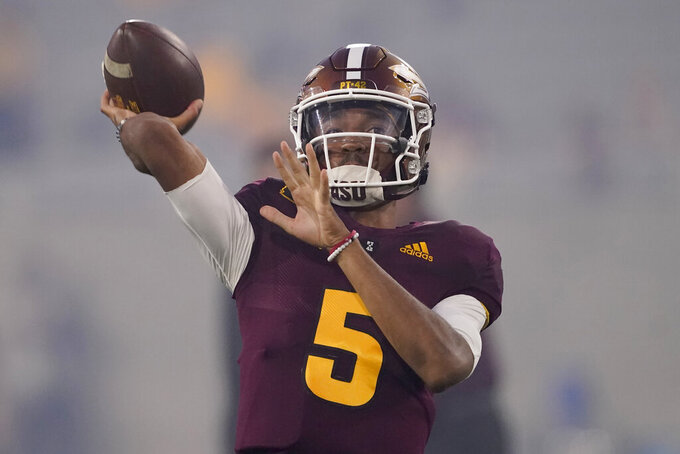 Arizona State quarterback Jayden Daniels (5) warms up prior to an NCAA college football game against UNLV, Saturday, Sept. 11, 2021, in Tempe, Ariz. (AP Photo/Matt York)