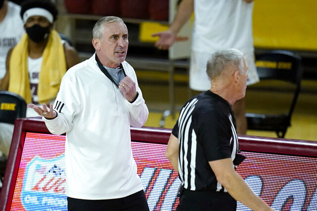 Arizona State coach Bobby Hurley, left, argues with a referee after a technical foul was called on the Arizona State bench during the second half of the team's NCAA college basketball game Southern California on Saturday, Jan. 9, 2021, in Tempe, Ariz. USC won 73-64. (AP Photo/Ross D. Franklin)