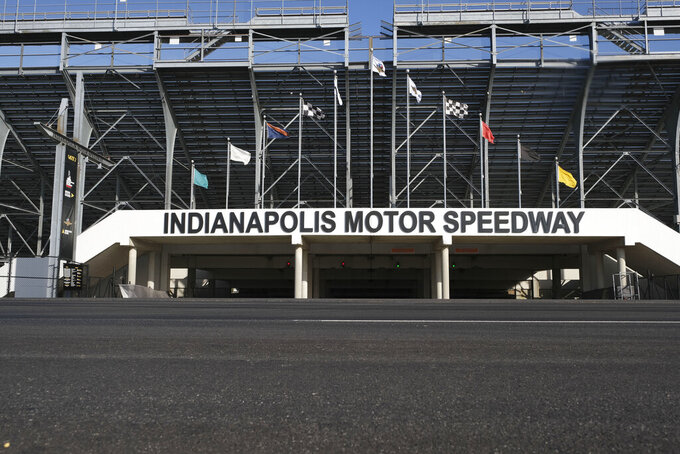 The main gate of the Indianapolis Motor Speedway is shown Monday, Nov. 4, 2019. Indianapolis Motor Speedway and the IndyCar Series were sold to Penske Entertainment Corp. in a stunning move Monday that relinquishes control of the iconic speedway from the Hulman family after 74 years. (AP Photo/AJ Mast)