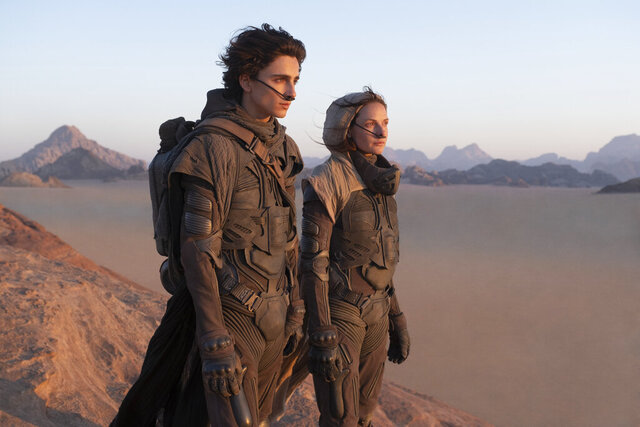 This image released by Warner Bros. Entertainment shows Timothee Chalamet, left, and Rebecca Ferguson in a scene from