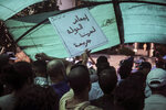 People stage a demonstration outside a court in solidarity with detained journalist Hajar Raissouni, in Rabat, Morocco, Monday, Sept. 9, 2019. Banner in Arabic reads