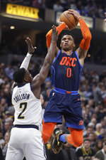 Oklahoma City Thunder's Russell Westbrook (0) shoots over Indiana Pacers' Darren Collison (2) during the first half of an NBA basketball game, Thursday, March 14, 2019, in Indianapolis. (AP Photo/Darron Cummings)