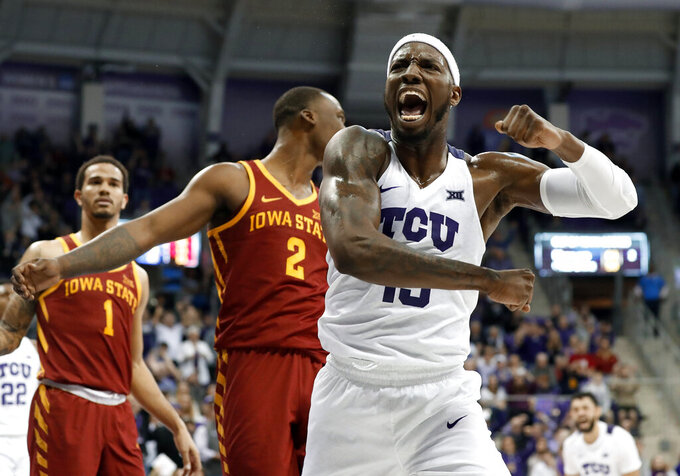 TCU forward JD Miller (15) celebrates sinking a basket as Iowa State's Nick Weiler-Babb (1) and Cameron Lard (2) watch late in the second half of an NCAA college basketball game in Fort Worth, Texas, Saturday, Feb. 23, 2019. TCU won 75-72. (AP Photo/Tony Gutierrez)