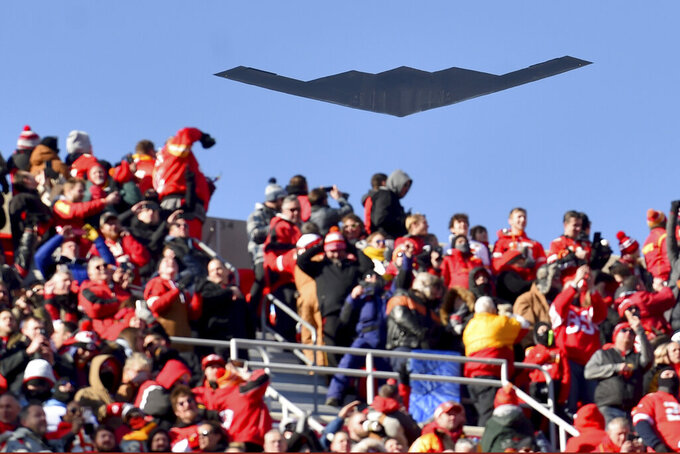 A B-2 bomber flies over spectators at Arrowhead Stadium before an NFL AFC Championship football game between the Kansas City Chiefs and the Tennessee Titans, Sunday, Jan. 19, 2020, in Kansas City, MO. (AP Photo/Ed Zurga)