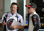 Kevin Harvick, right, talks with a crew member during practice for the NASCAR Cup auto race at the Homestead-Miami Speedway, Friday, Nov. 16, 2018, in Homestead, Fla. (AP Photo/Terry Renna)